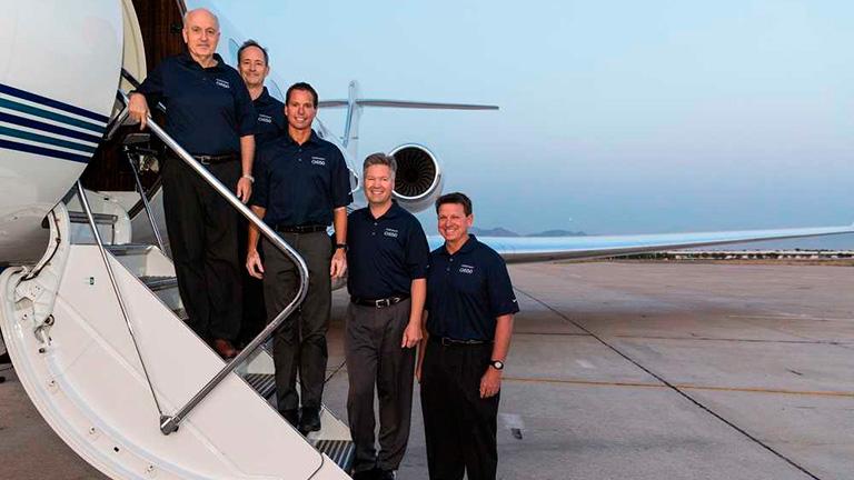 Команда пилотов G650 после кругосветного полёта