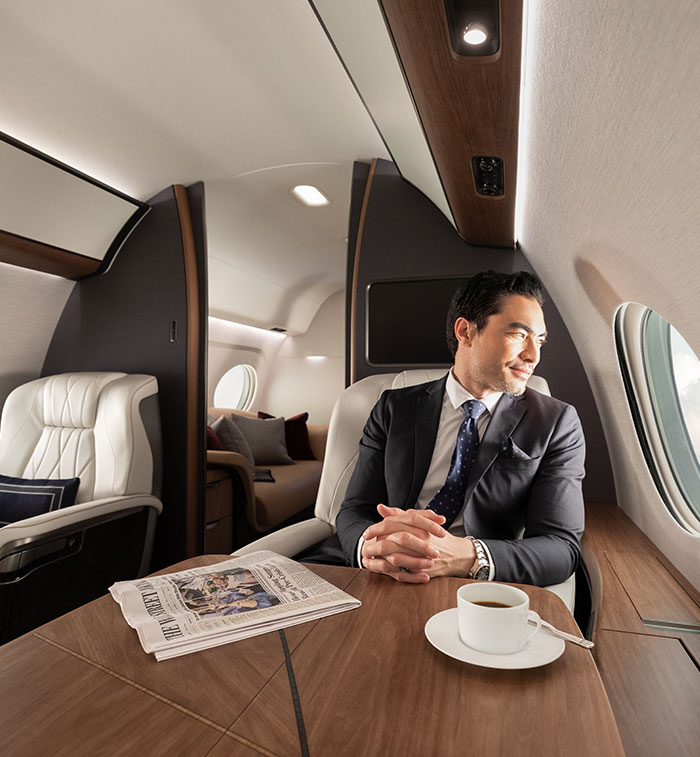 Businessman enjoys view out his private airplane